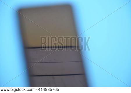 High Angle Of Unique Blurred Abstract Photo Of A Phone Over Blue Background.