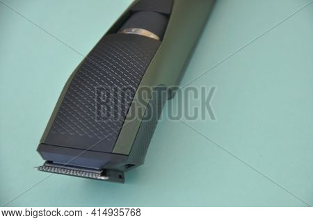 Close Up Shot Of Beard Trimmer Without Comb Isolated On Green Background.