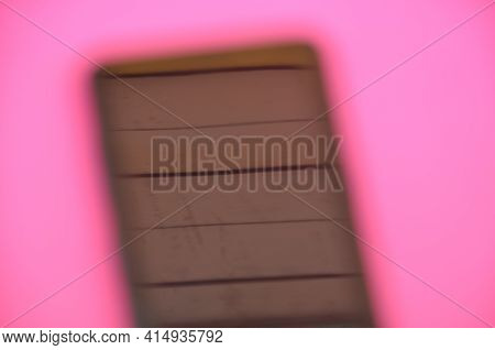 High Angle Of Unique Photo Of Blurred Phone Over Pink Background