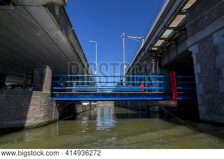 Amsterdam, Netherlands - July 02, 2018: Fragment Of The Bridge Over The Canals Of Amsterdam Under Th