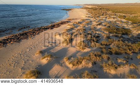 Deserted Rocky Beach At Sunset Aerial Shot