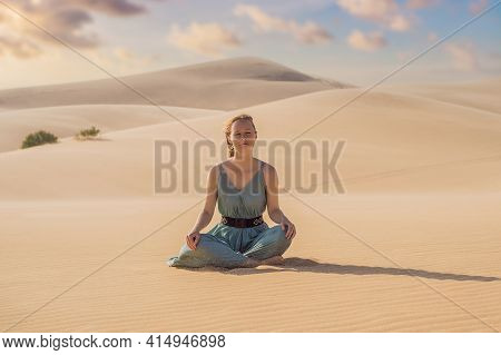 Desert Meditation. Young Beautiful Woman Traveling In The Desert. Sandy Dunes And Blue Sky On Sunny