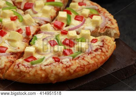 Pizza_paneer Makhani , Home Made Delicious  Pizza  Made Using Red And Green Bell Pepper ,onion ,pane