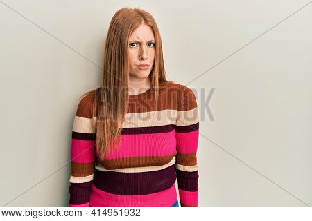 Young irish woman wearing casual clothes skeptic and nervous, frowning upset because of problem. negative person.