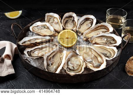 Oysters On A Platter. A Dozen Of Fresh Oysters With Lemon