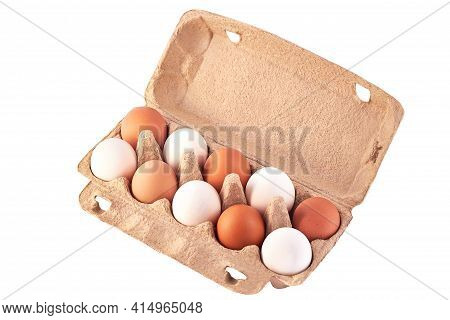 A Cardboard Egg Box With Ten Brown And White Eggs Isolated By A Cut-off Path. Isolate. White Egg In