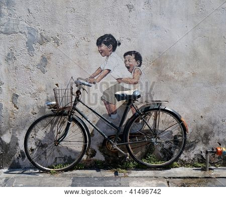 PENANG, MALAYSIA-DEC.9: Street Mural entitled 'LIttle Children on a Bicycle' painted by Ernest Zacharevic in Penang on Dec.9, 2012. It was painted in conjunction with the 2012 George Town Festival.