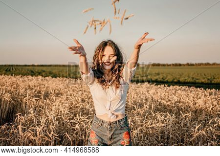 Wheat Crop, Harvest, Harvesting Agriculture, Economy. Young Brunette Woman With Hands Full Of Ripe W