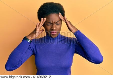 Young african american girl wearing casual clothes with hand on head, headache because stress. suffering migraine.