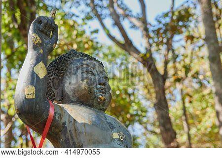 Phayao, Thailand - Dec 13, 2020: Left Frame Headshot The Birth Of Buddha Statue On Forest Background