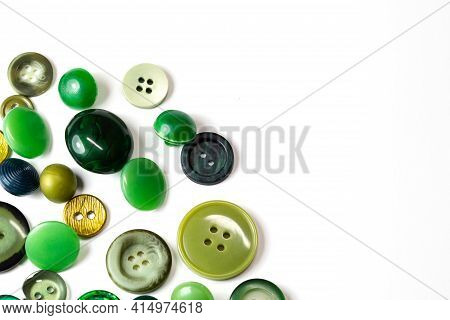 Colorful Green Buttons On A White Background. Lots Of Green Buttons. Old Vintage Buttons Close Up. C