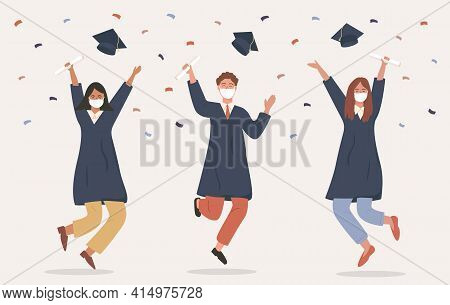 Graduated Students Jumping In Academic Gown Or Robe, Cap, Holding Diploma And Wearing Medical Face M