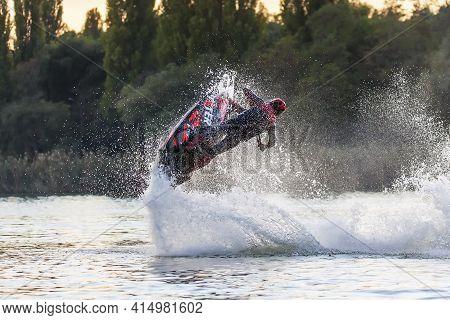 Krasnodar, Russia - October 25, 2020: Jet Ski Sportsman Runs Freestyle Splashing At Sunset During So