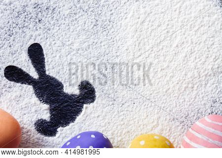 Traces Of Flour Or Powdered Sugar In The Form Of Easter Figures On The Kitchen Table In The Process
