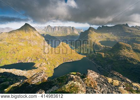 Steep Mountains Of Lofoten Island On A Sunny Arctic Day. View From The Top Of Hermannsdalstinden Pea