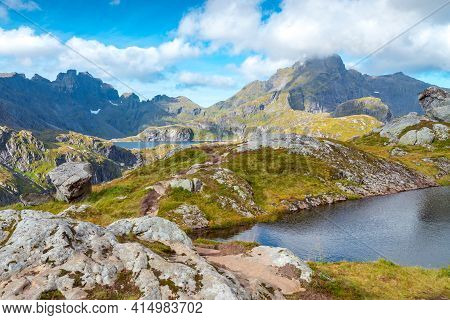 Steep Mountains Of Lofoten Island On A Sunny Arctic Day. Hermannsdalstinden Peak From The Trail From