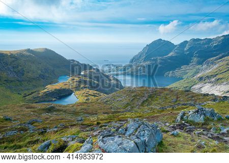 Mountains Of Lofoten Island On A Sunny Arctic Day. View From Trail To Hermannsdalstinden Peak. Hikin