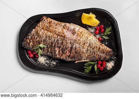 Delicious Cooked Fish With Veggies. High Quality And Resolution Beautiful Photo Concept
