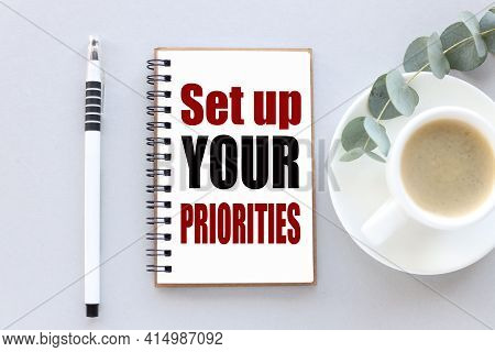 Set Up Your Priorities. Text On White Paper On Gray Background
