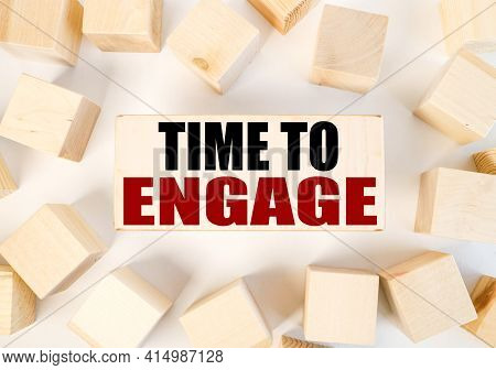 Time To Engage. Text On A Piece Of Wood. On A White Background