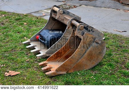 Two Spoons Of An Excavator Lie Freely On The Lawn. The Excavator Chooses The Size According To The C