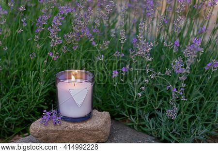 Homemade Candle With Herbal Scent Against A Background Of Blooming Lavender. Magical Rituals And Pra