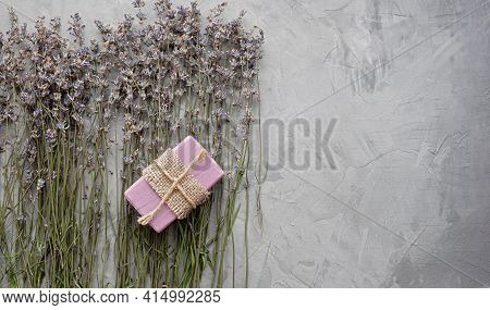 Handmade Soap With Natural Ingredients And Dry Lavender Flowers On A Gray Concrete Background. Top V