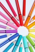 a bunch of colorful pencils put in circle to form some kind of rainbow sun poster