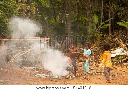 BERDUT, MALAYSIA - APR 8: Unidentified children Orang Asli in his village on Apr 8, 2013 in Berdut, Malaysia. More than 76% of all Orang Asli live below the poverty line, life expectancy- 53 years old