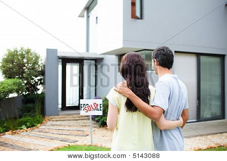 Newlyweds With Their New House