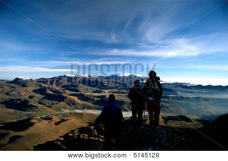 Men On Top Of A Mountain