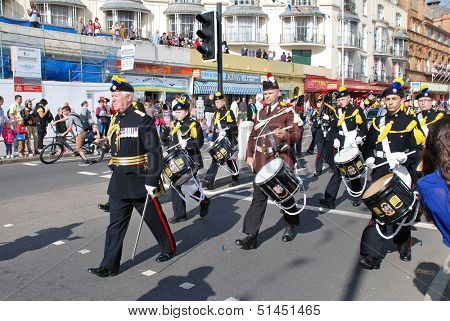 HASTINGS, ENGLAND - AUGUST 10: The Corps of Drums of the Farnborough Royal British Legion parade along the seafront at the annual Old Town Carnival on August 10, 2013 in Hastings, East Sussex.