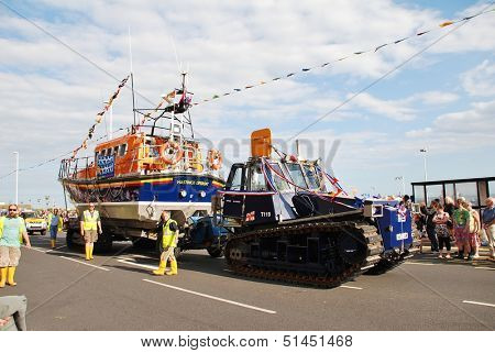 HASTINGS, ENGLAND - AUGUST 10: The Hastings lifeboat Sealink Endeavour takes part in the annual Old Town Carnival parade on August 10, 2013  in Hastings, East Sussex.The boat entered service in 1989.