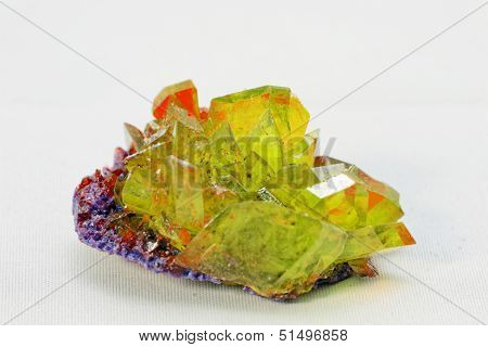 Close up picture about a crystal with emerald color on white background (green crystal) poster
