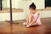 Cute little girl practicing her ballet poster