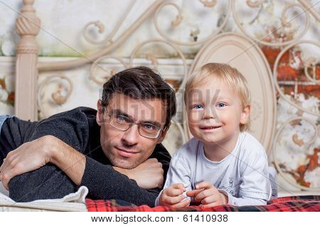 Portrait Of Happy Father with his to kid