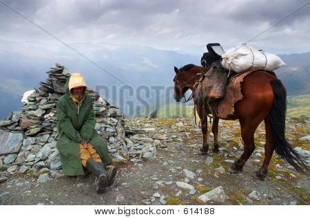 Men, Horse And Mountains.