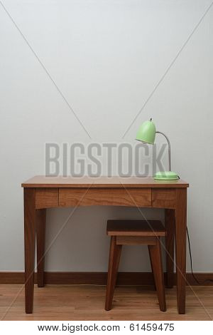 Wooden Brown Table With A Lamp In Bedroom