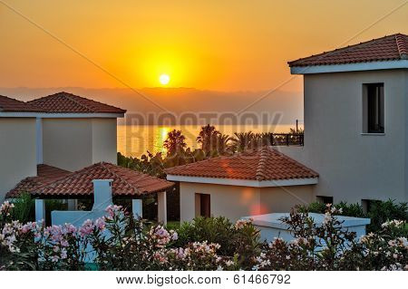 Sunset over luxurious holiday beach villas for rent on Cyprus poster