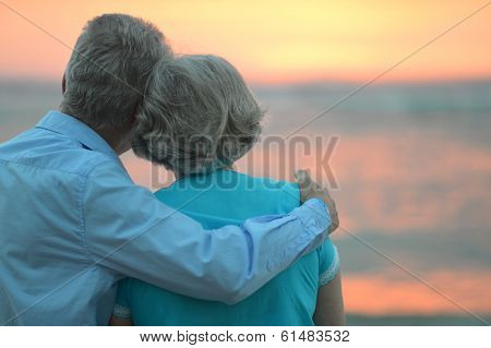 Elderly couple at sunset
