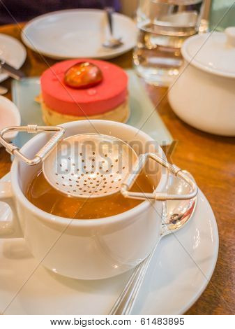 Hot Tea Cup And Piece Of Cake
