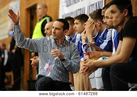 KAPOSVAR, HUNGARY - MARCH 8: Adam Fekete (Kaposvar trainer) in action at a Hungarian Championship basketball game with Kaposvar (white) vs. Paks (red) on March 8, 2014 in Kaposvar, Hungary.