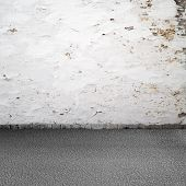 Empty grunge urban interior background. Old white wall and asphalt poster