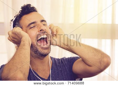 Exuberant Man Listening To His Music