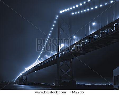 Fog hovering atop the Bay Bridge