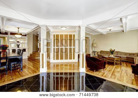 Luxury Interior. Foyer With Black Shiny Tile Floor, Columns And Coffered Ceiling System