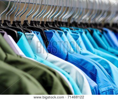 Many shirts on a rack