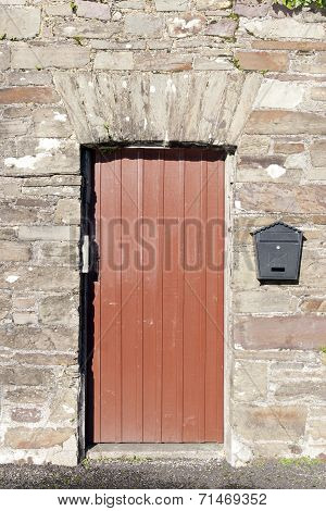 Brown Wooden Doorway And A Post Box