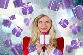 Pretty girl in santa outfit holding gift against light glowing dots on blue poster