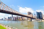A view from Roosevelt Island onto Lower East Side Manhattan with Queensboro Bridge. poster